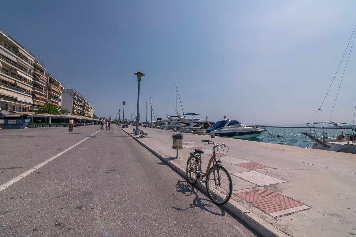 This is a photo of the seafront promenade in Volos. There is a bicycle in the foreground.