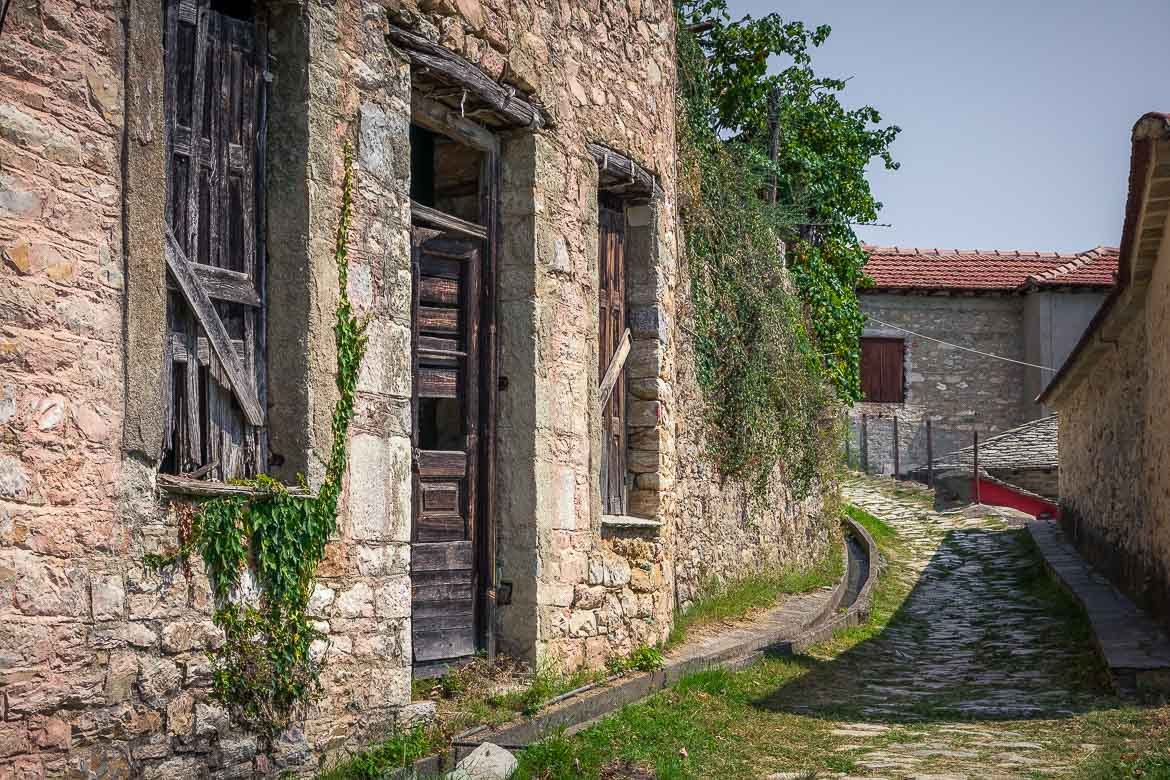 This image shows a stone path in Milies. There is also a gorgeous yet abandoned stone house.