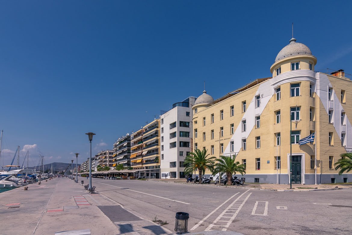This image shows the iconic Papastratos Building. It is an imposing yellow colour with 2 white stripes.