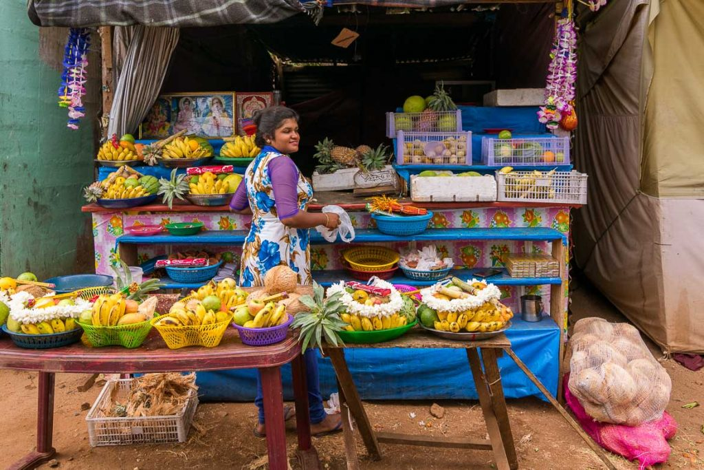 This photo shows a smiling Sri Lankan fruit vendor looking radiant in her colourful outfit. It is an open air market. We chose this photo to be the featured image for our article: Why visit Sri Lanka for your first Asia trip: Top 6 reasons because it illustrates the kind and welcoming disposition of the Sri Lankan people. Our top reason to visit Sri Lanka is its people.