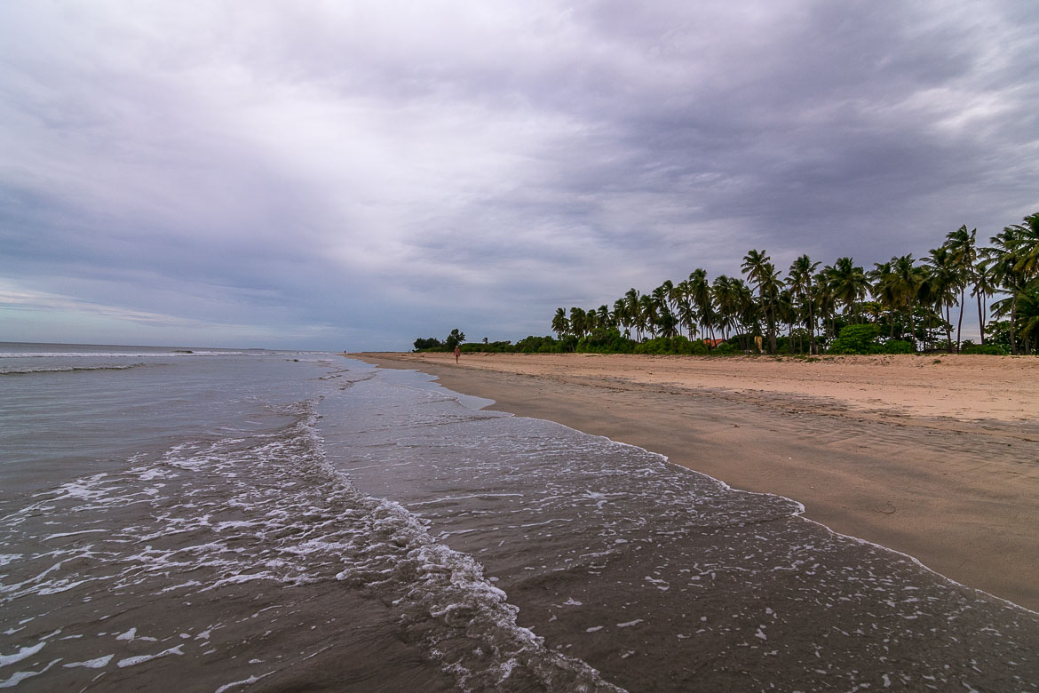 This is a photo of Nilaveli Beach around sunset. There is noone on the beach apart from the sea, the sand and the coconut trees.