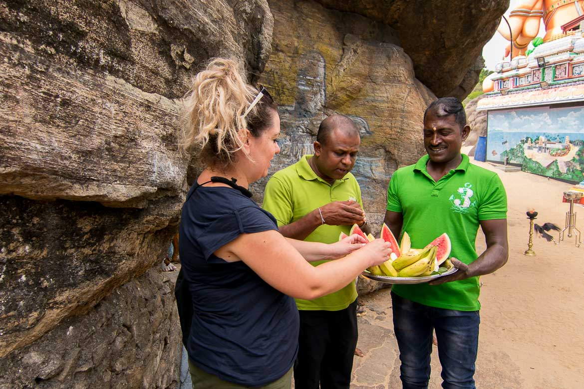 This is a photo of Maria with Pradeep, our driver, and another local guy enjoying a platter of fresh fruit outside a Hindu temple.