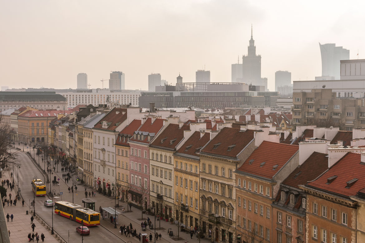 The view from the bell tower of St. Anne's church. In the foreground, the pastel-coloured buildings lining the Royal Route. In the background Warsaw's dramatic Manhattan-like skyline. Winter in Warsaw. Top things to do and Warsaw city guide.