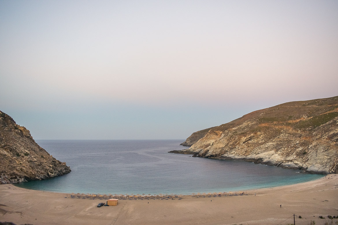This is a panoramic shot of Zorkos Beach in Andros at sunset. The sea is absolutely calm and the beach is almost empty. This photo reflects a beautiful moment in one of the most scenic beaches in Andros. This is why we've chosen this photo to be the featured image of our article the 20 most spectacular Andros Beaches Greece.